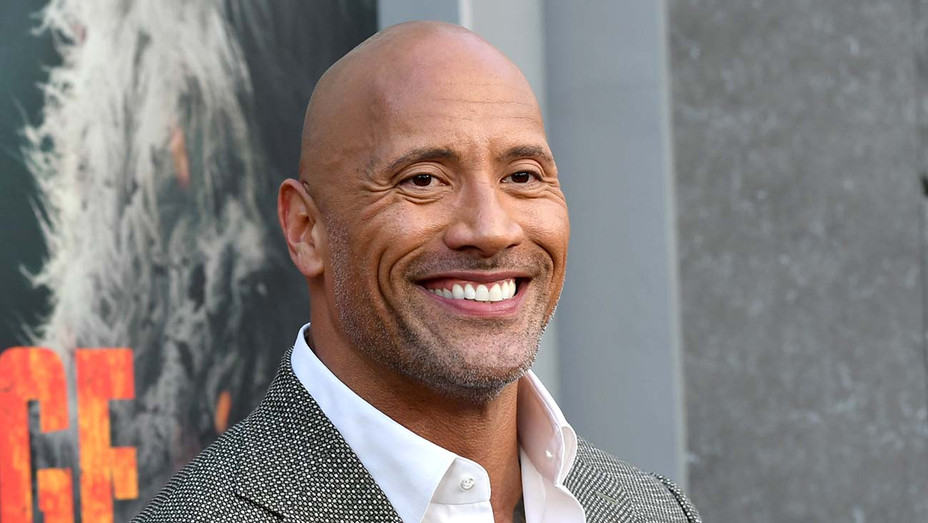 Dwayne Johnson arrives at the premiere of Warner Bros. Pictures' Rampage - Getty -H 2019