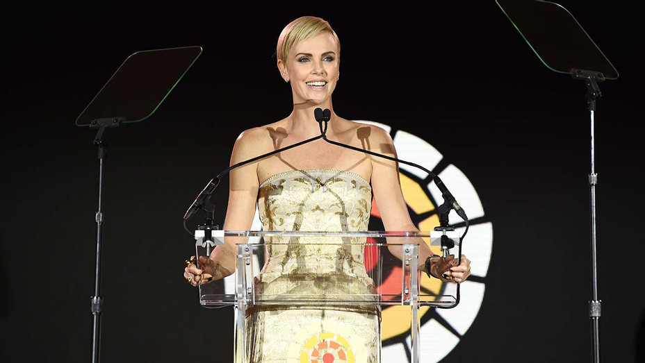 Charlize Theron speaks onstage during The Charlize Theron Africa Outreach Project fundraising event - Getty -H 2019