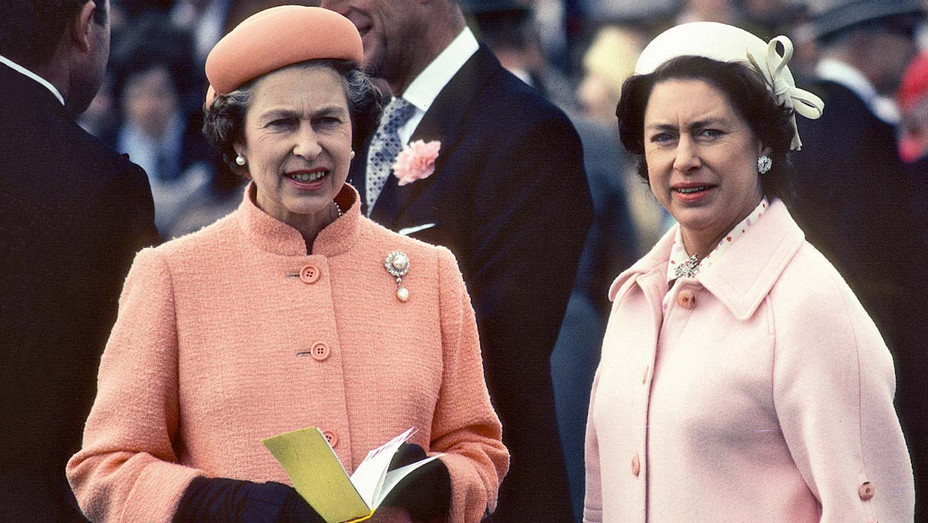 ONE TIME USE ONLY - Queen Elizabeth ll and her sister Princess Margaret attend the Epsom Derby on June 06, 1979- Getty-H 2019
