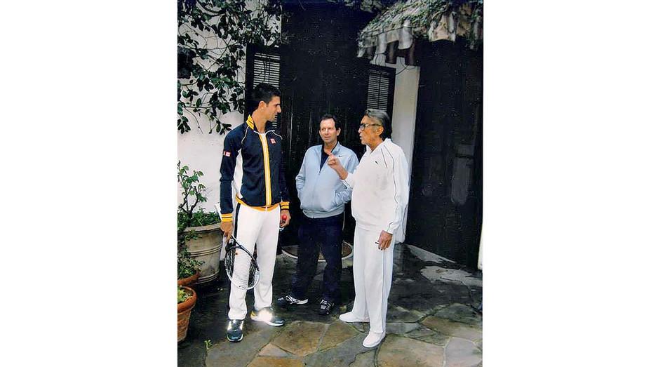 Tennis legend Novak Djokovic, Darryl Goldman and Robert Evans, home courtside.- Publicity - H 2019