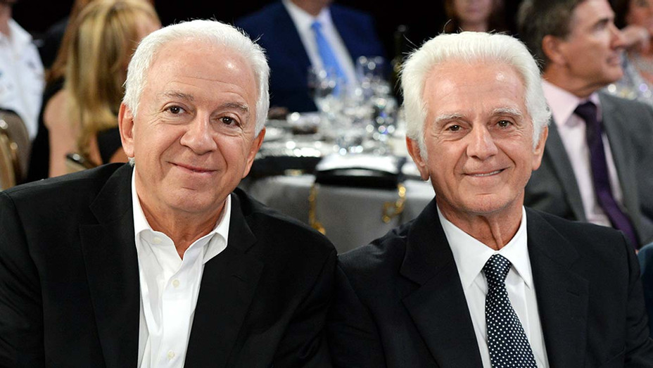 Fashion designer Paul Marciano (L) and businessman Maurice Marciano  - Getty - H 2019