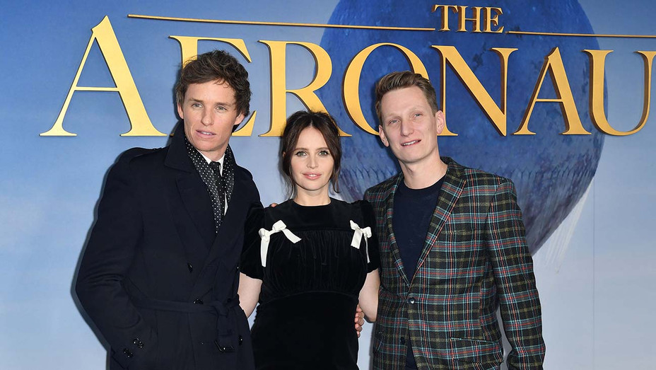 "Eddie Redmayne, Felicity Jones, and Tom Harper arrive for the New York premiere of ""The Aeronauts"" - Getty-H 2019"