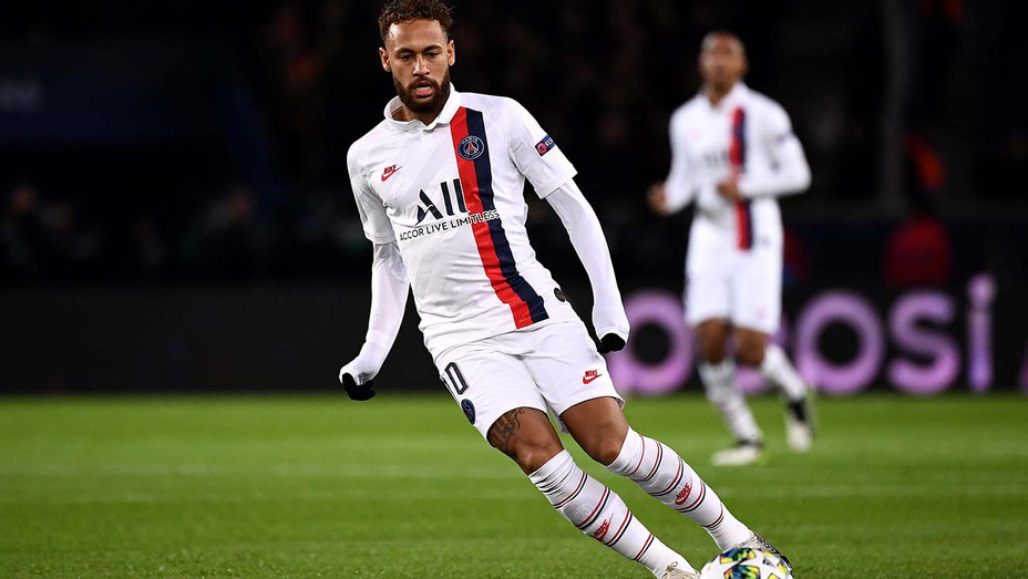 Paris Saint-Germain's Brazilian forward Neymar looks at the ball during the UEFA Champions League Group Match- H 2019