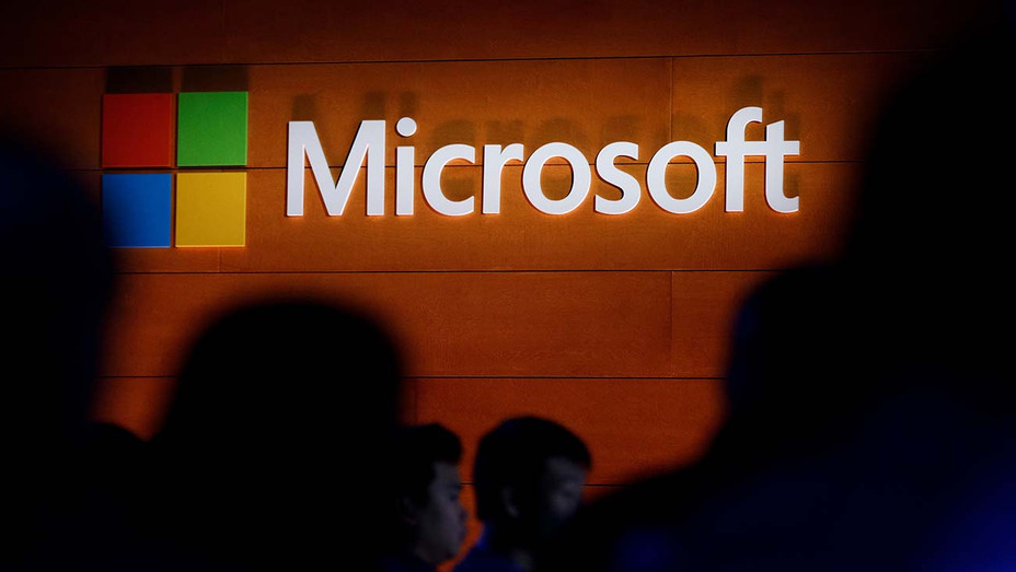 The Microsoft logo is illuminated on a wall during a Microsoft launch event - Getty-H 2020