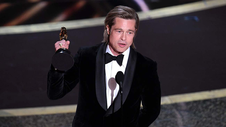 Brad Pitt accepts the Actor in a Supporting Role award for 'Once Upon a Time...in Hollywood' - Oscars 2020 - Getty - H 2020