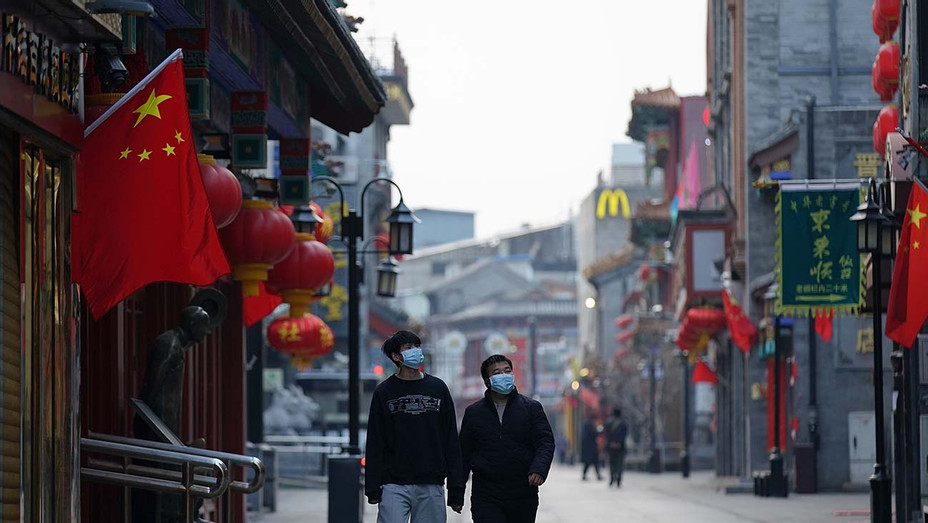 Chinese people wear protective masks_02-25-20 Beijing, China - Getty - H 2020
