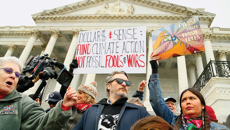 Joaquin Phoenix stands with protestors on the steps of the U.S. Capitol Building - Getty -H 2020