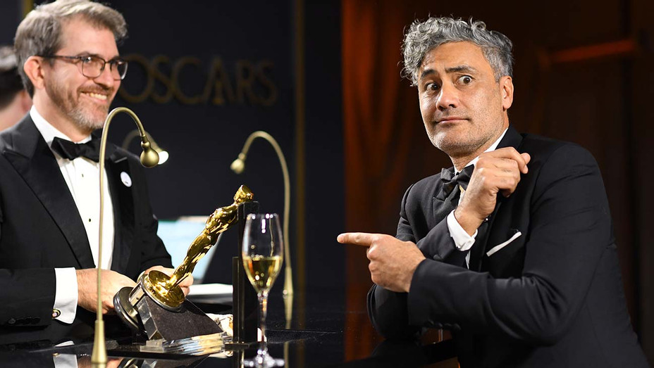 "Taika Waititi waits as his award for Best Adapted Screenplay for ""Jojo Rabbit"" - Getty-H 2020"