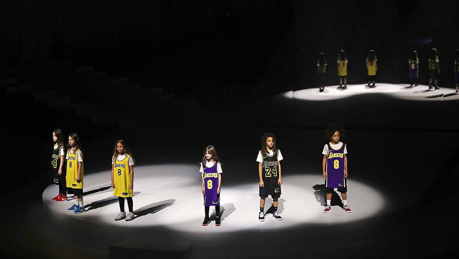 Models honoring Kobe Bryant during the 2020 Tokyo Olympic collection fashion show February 05, 2020- Getty-H 2020
