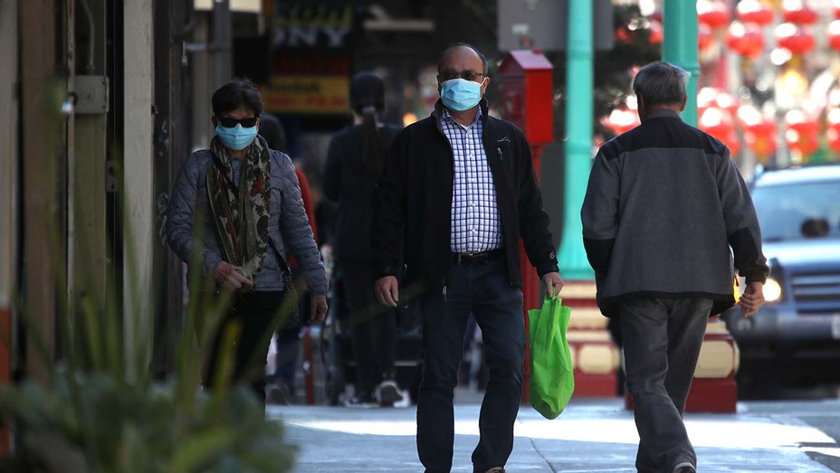 People wear surgical masks_SAN FRANCISCO, CALIFORNIA - Getty - H 2020