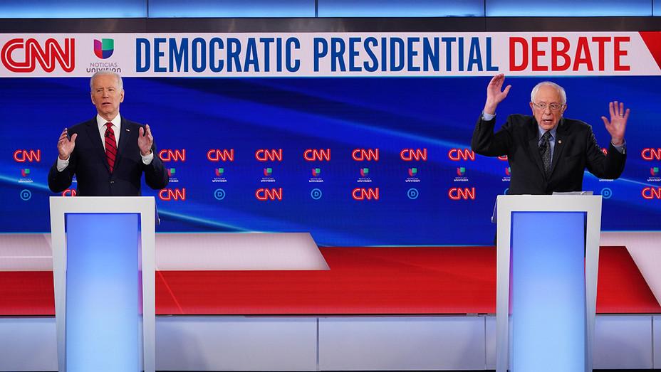 Joe Biden Bernie Sanders - hands raised - debate - H Getty 2020