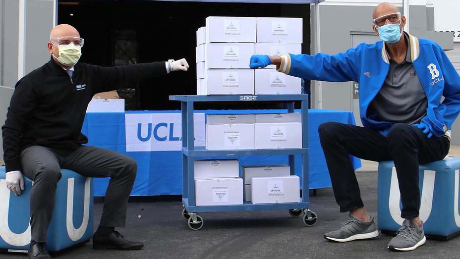 Kareem Donating Goggles UCLA - Publicity -H 2020