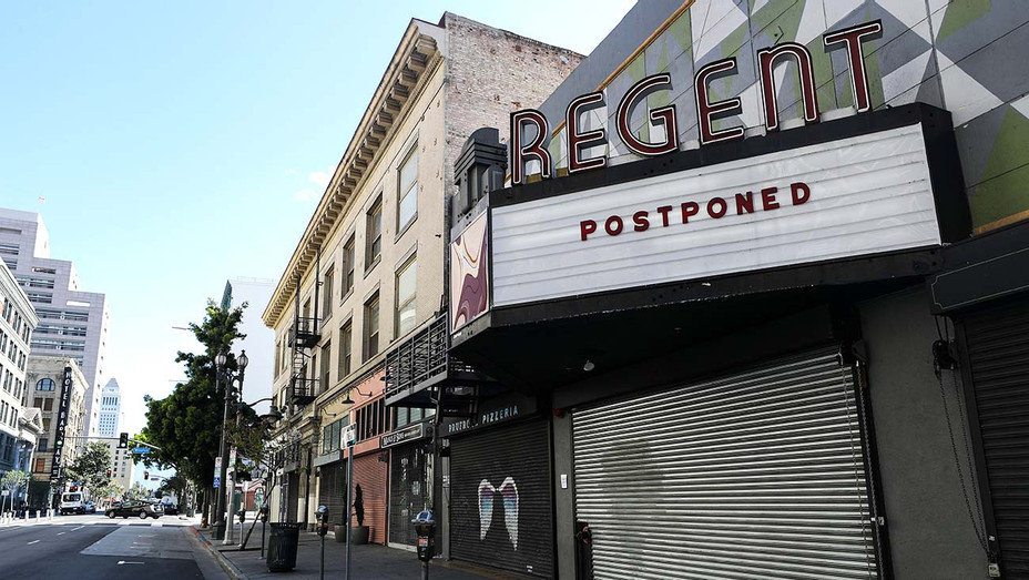 'Postponed' is written on the marquee of the shuttered Regent Theater amid the coronavirus pandemic on March 26, 2020 - Getty -H 2020