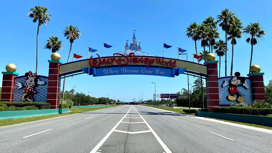 An empty road leads into a deserted Disney resort due to the COVID-19 pandemic in Kissimmee, Florida on May 5, 2020- Getty - H 2020