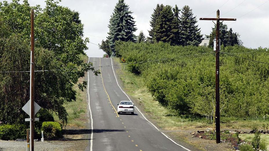 Car Drives on Young Grade Road Near Yakima County, Washington State - 2006 - H - 2020