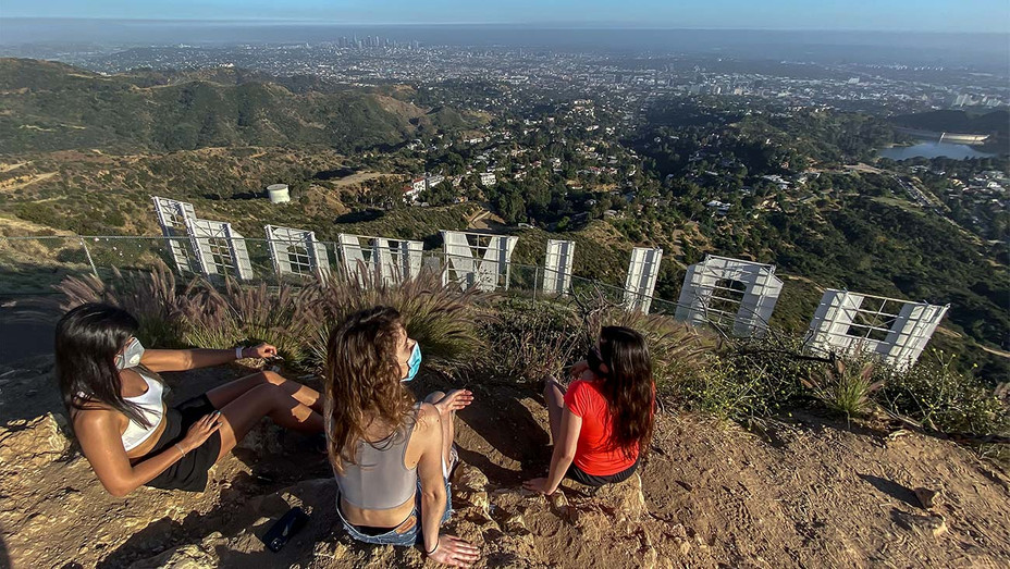 people wear masks Griffith Park hollywood sign- Coronavirus, COVID-19, pandemic in Los Angeles, California on May 24, 2020-Getty - H 2020