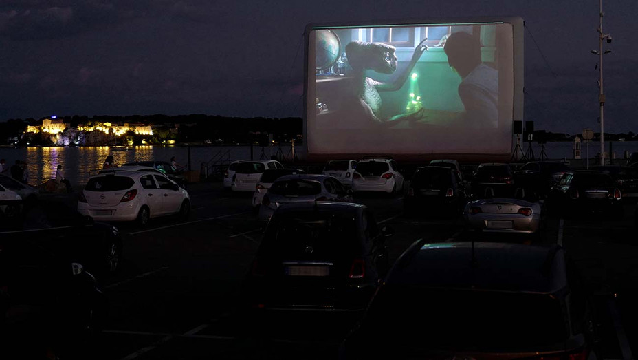 "Spectators in their vehicle attend a drive-in movie screening of ""ET"" by US director Steven Spielberg- coronavirus - May 20, 2020- Getty - H 2020"
