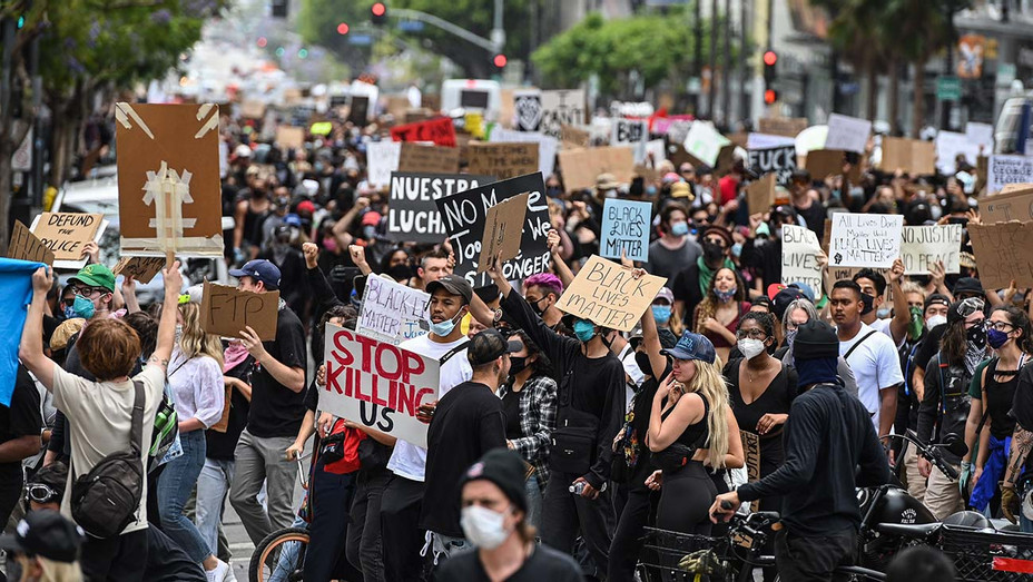 Demonstrators march through the streets of Hollywood, California, on June 2, 2020 - Getty-H 2020