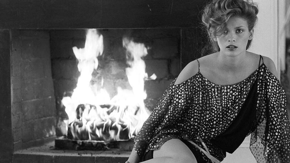 ONE TIME USE ONLY - Gia Carangi sits at fireplace- Andrea Blanch Photo -Getty Images -H 2020