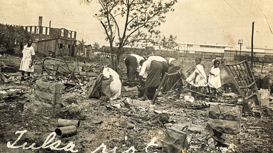 ONE TIME USE ONLY Tulsa Race Massacre-People searching through rubble after the Tulsa Race Massacre, Tulsa, Oklahoma, June 1921 - getty - H 2020