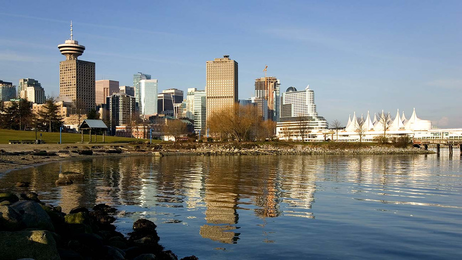 The sun rises on the skyline -Vancouver, Canada - Getty - H 2020