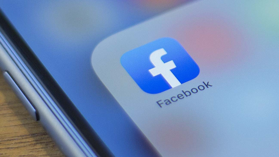 Facebook - logo is seen on a phone -Getty - H 2020