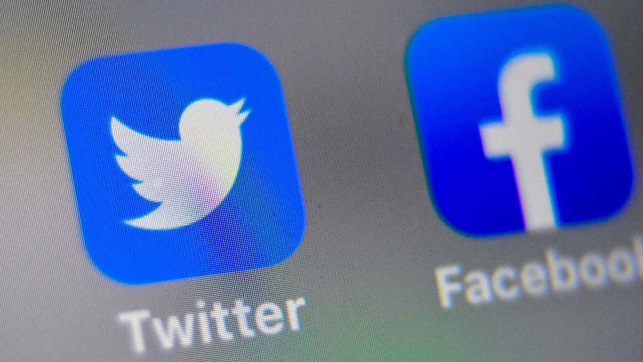 Twitter and Facebook -On Phone - logos of US social networking websites  -Getty -H 2020