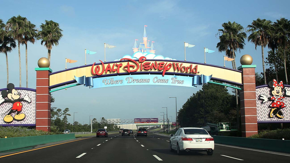 Visitors drive past a sign welcoming them to Walt Disney World in Orlando, Florida-Getty - H 2020