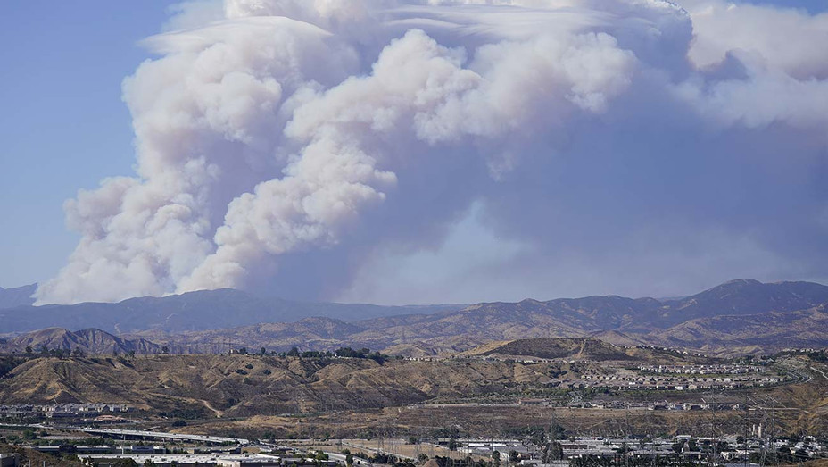 ONE TIME USE ONLY - The Lake Fire sends a plume of smoke over the Angeles National Forest Wednesday, Aug. 12, 2020, in a view from Santa Clarita, Calif- AP IMAGE - H 2020