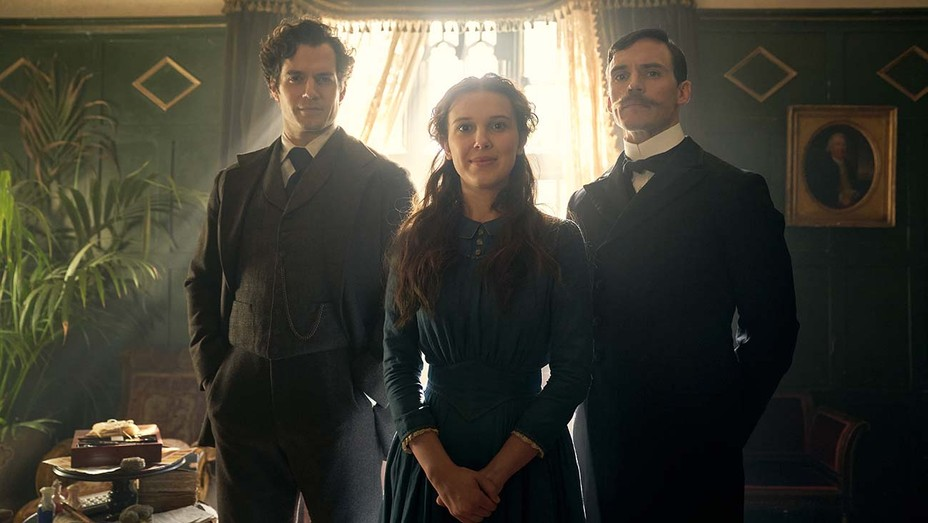 MILLIE BOBBY BROWN, SAM CLAFLIN and HENRY CAVILL in ENOLA HOLMES.