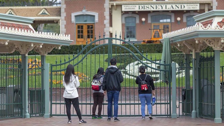 Disneyland - People stand outside the gates