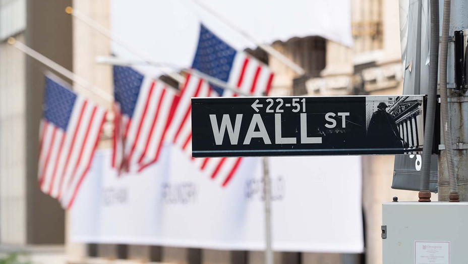 Wall Street street sign with the New York Stock Exchange