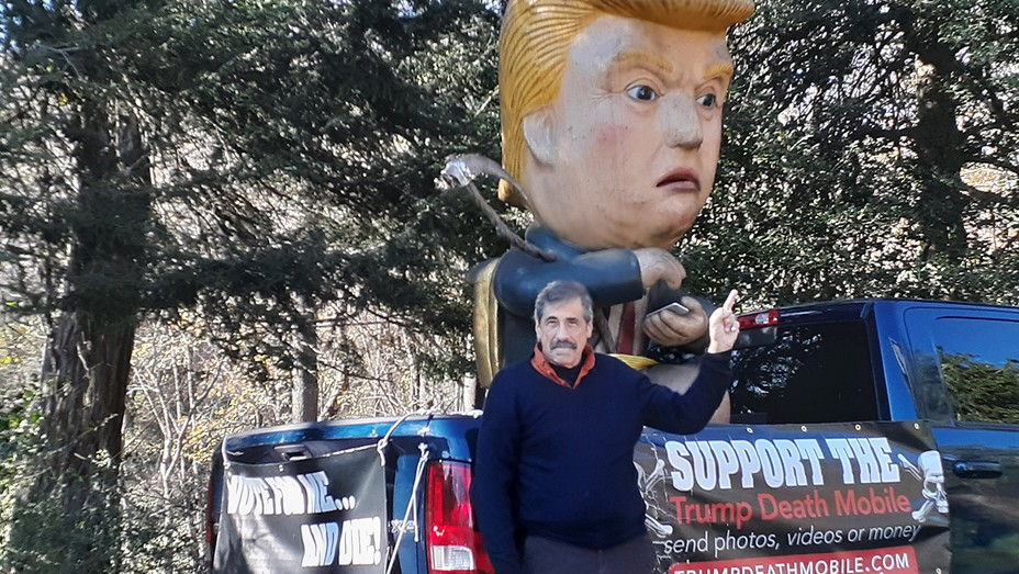 Don Lessem with his Dumping Trump robot