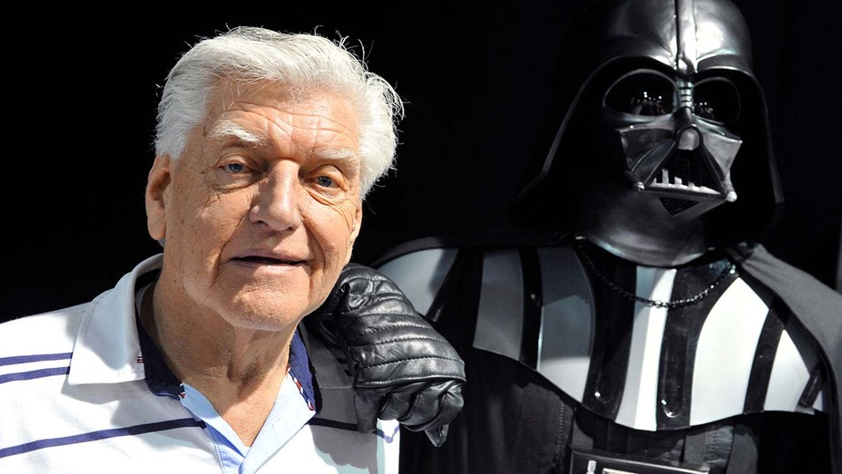 David Prowse and fan in Darth Vader costume at 2013 Star Wars convention