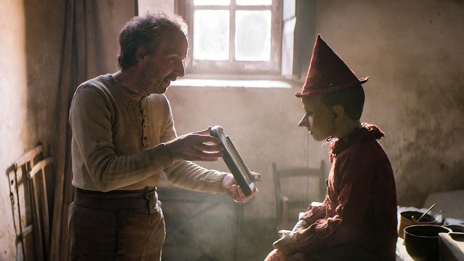 Roberto Benigni as Geppetto and Federico Ielapi as Pinocchio in Matteo Garrone's Pinocchio.
