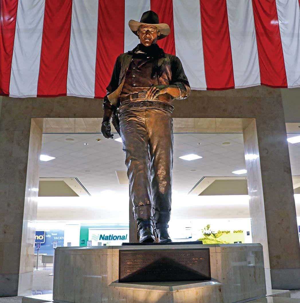 "A statue of ""The Duke"" at Orange County's John Wayne Airport."