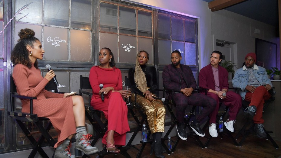 """Elaine Welteroth, Issa Rae, Yvonne Orji, Jay Ellis, Alexander Hodge and Prentice Penny speak at the Lowkey """"Insecure"""" Dinner presented by Our Stories to Tell at Firewood on January 25, 2020 in Park City, Utah."""