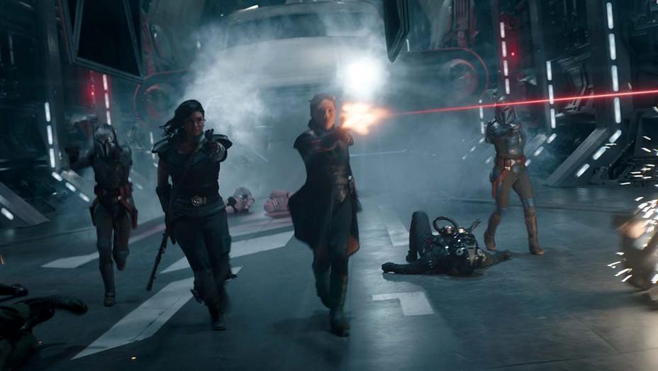 Katee Sackhoff (as Bo-Katan Kryze), Gina Carano (as Cara Dune), Ming-Na Wen (as Fennec) and Mercedes Varnado (as Koska Reeves) fight Stormtroopers in The Mandalorian Chapter 16.
