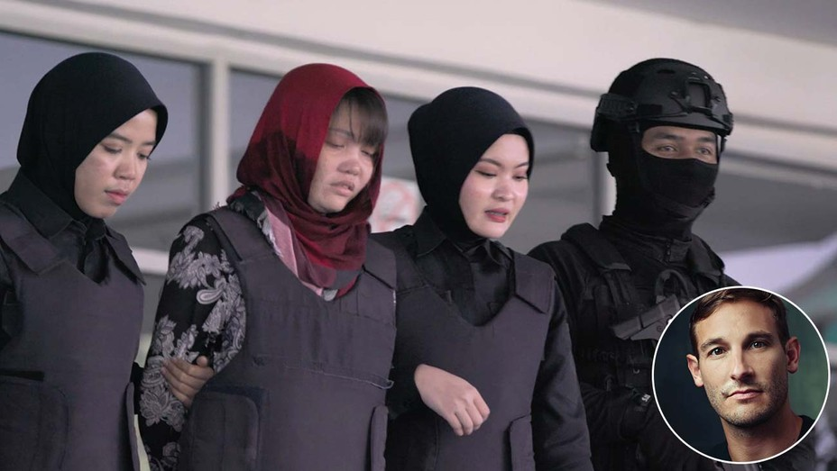 Suspect Doan Thi Huong (in red head covering) in policecustody.