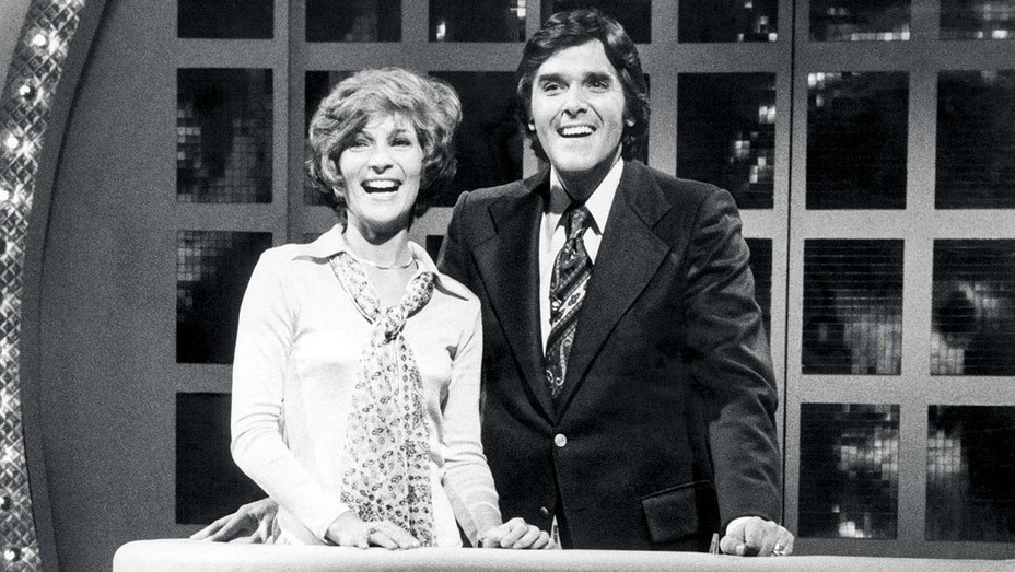 WHEEL OF FORTUNE - Co-host Susan Stafford, Host Chuck Woolery, 1975.