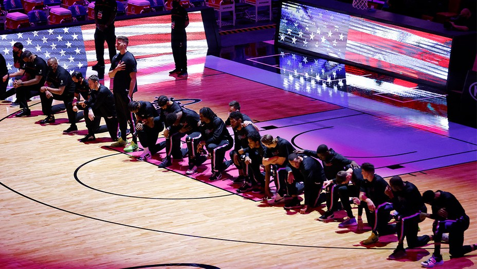 Members of the Miami Heat kneel during the playing of the national anthem prior to the game against the Boston Celtics at American Airlines Arena on January 06, 2021 in Miami, Florida.