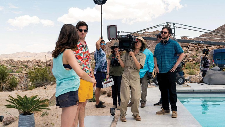 """<p>""""Preproduction was hairy … as was production … as was post,"""" says producer Becky Sloviter of the movie. Locations included Joshua Tree, a cave in Griffith Park, the Four Aces movie ranch in Palmdale and a residential backyard in Santa Clarita, with some days having as many as 70individual setups. From left: Cristin Milioti, Andy Samberg, cinematographer Quyen Tran (behind camera) and director Max Barbakow.</p>"""