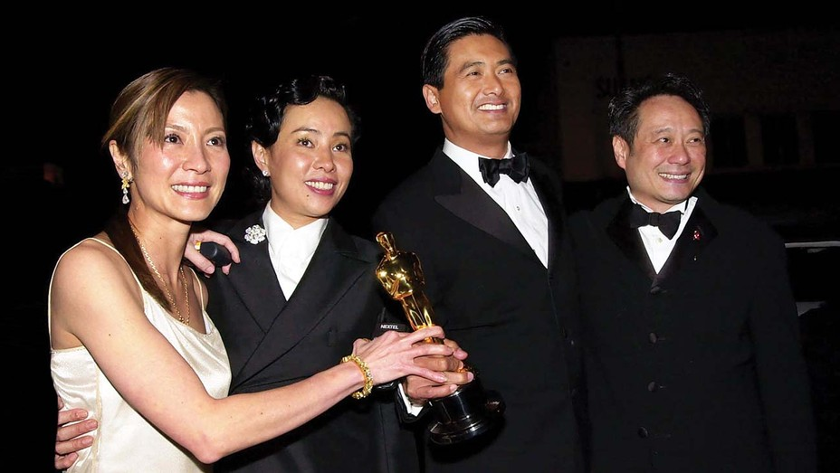 'Crouching Tiger, Hidden Dragon' stars Michelle Yeoh (left) and Chow Yun-fat (second from right) celebrated with Chow's wife, Jasmine, and director Ang Lee at Sony's Oscars afterparty on