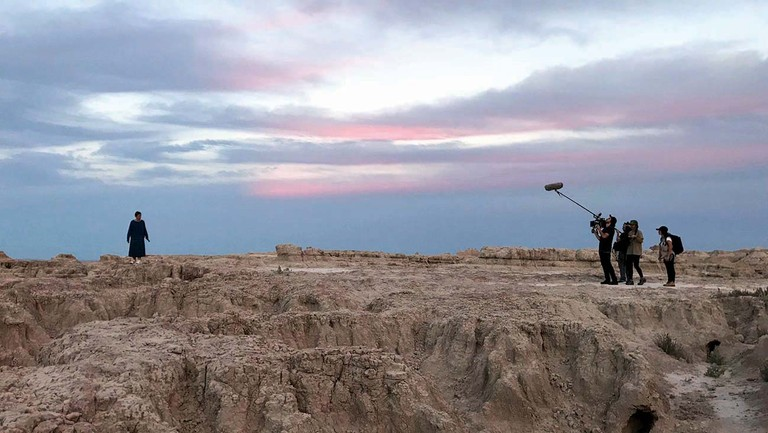"<p>Frances McDormand (far left) filming in the Badlands of South Dakota, the first stop on the 'Nomadland' shooting schedule. ""We were greedy and we wanted to capture as much of the American West as possible,"" says Chloé Zhao. </p>"