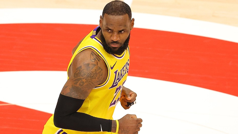 LeBron James reacts after hitting a three-point basket against the Atlanta Hawks during the second half at State Farm Arena on February 01, 2021, in Atlanta, Georgia.