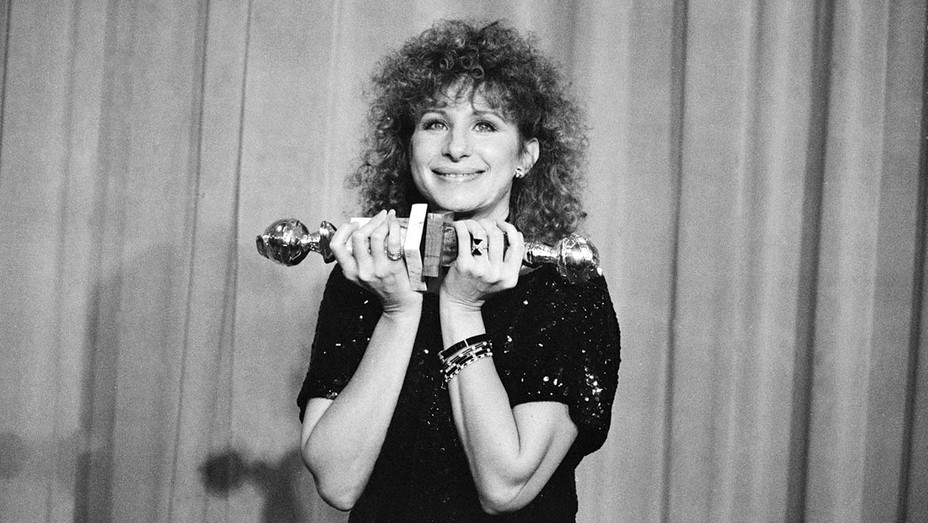 Barbra Streisand with the two Golden Globes she won, one for Best Director (Musical or Comedy) and one for Best Actress (Musical or Comedy), in Yentl. Streisand also directed the film. Los Angeles, 1984.