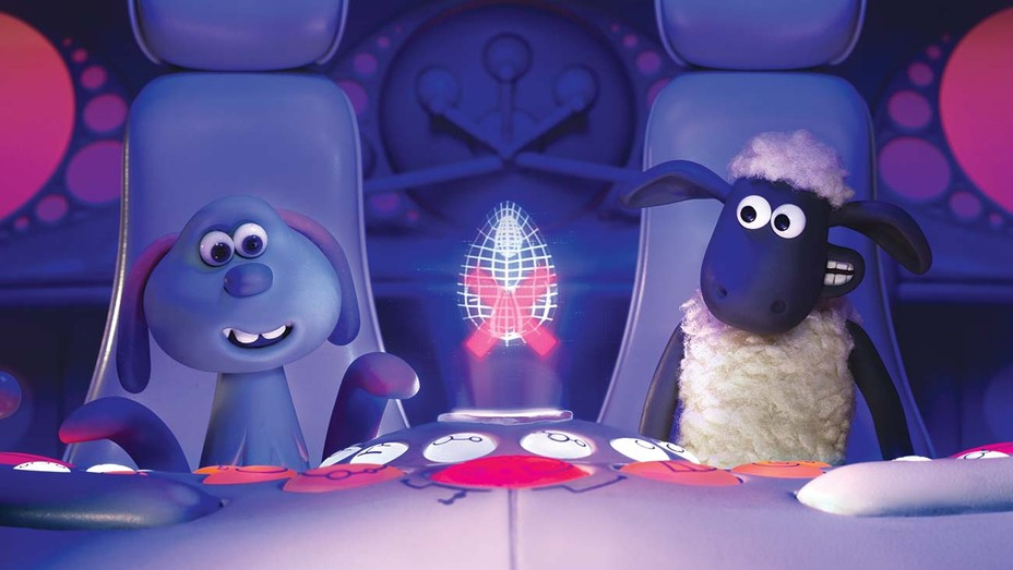 Shaun (right) and the extraterrestrial Lu-La inside a flying saucer designed in the shape of a clamshell.