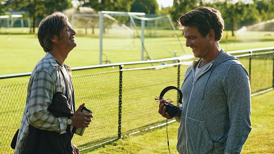 """""""Making this film may have kept me from insanity,"""" says Vinterberg (right), with Mikkelsen."""
