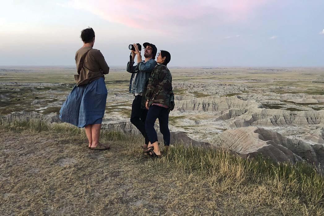 Nomadland star Frances McDormand and cinematographer Joshua James Richards with Zhao.